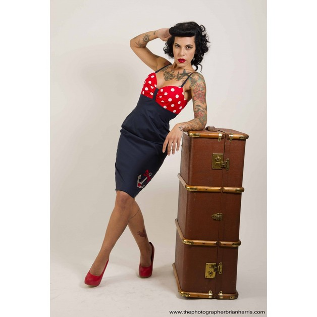 Striking Pin Up Girl Tattoo On Arm photo - 1