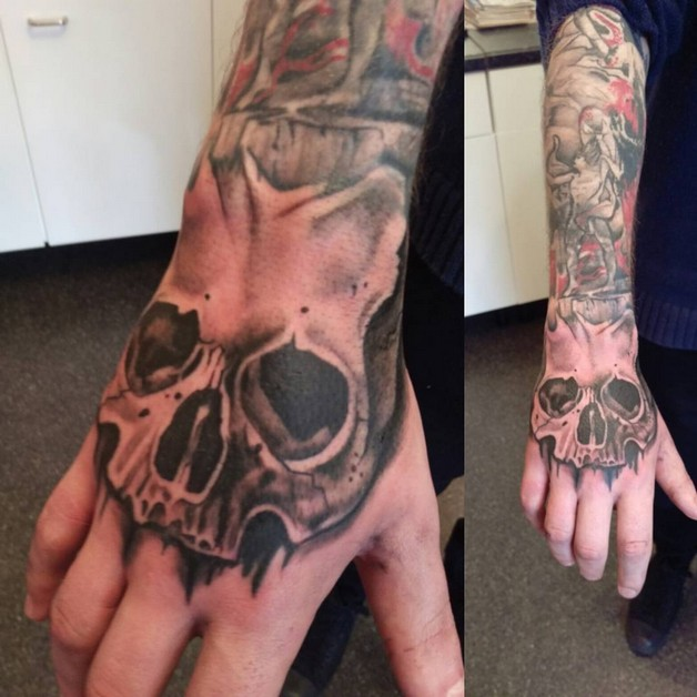 Superb Skull Hand Tattoo Design