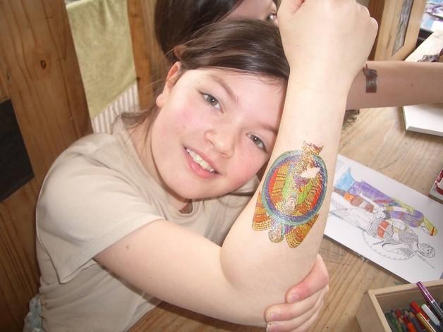 Teenage Girl Has Stained Glass Tattoo photo - 1