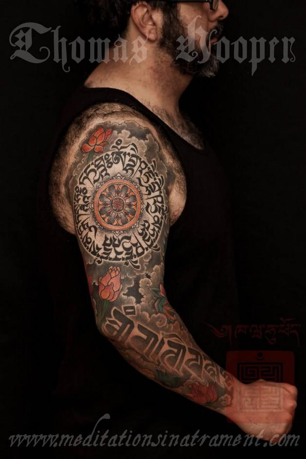 Tibetan Text Tattoo On Biceps photo - 1
