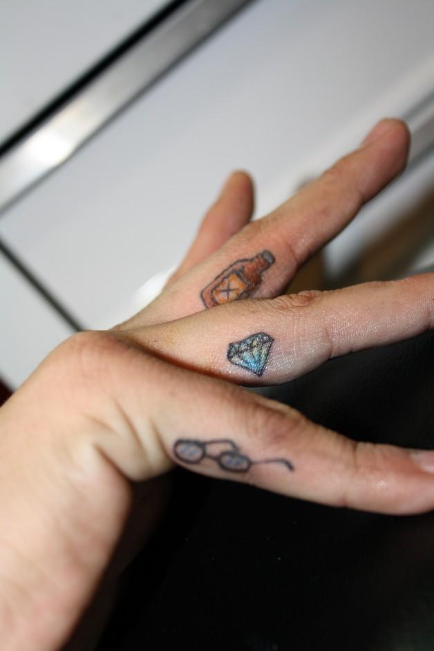 Tiny Diamond Tattoo On Finger