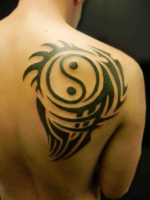 Tribal Ying Yang Tattoo On Chest photo - 1