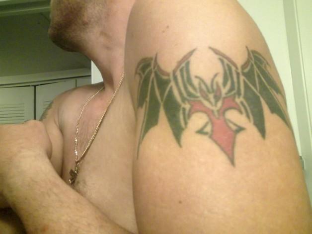 Vampire Bat Tattoo On Biceps photo - 1