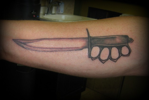 White Evil Rabbit With Knife Tattoo On Biceps photo - 1