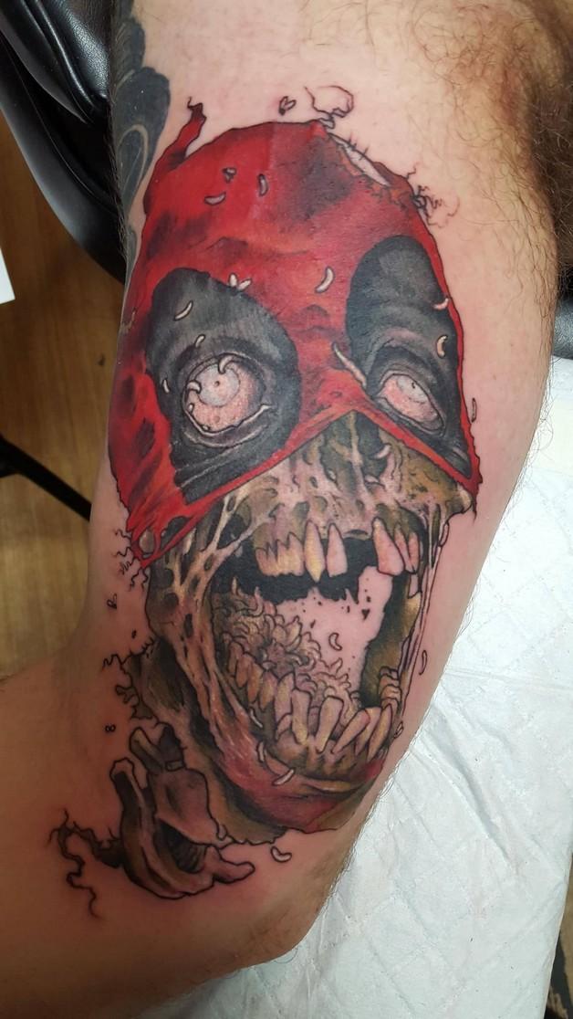 Zombie Rabbit Tattoo On Biceps photo - 1