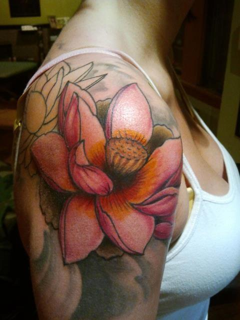 a beautiful tattoo of a hummingbird sipping nectar from a bouquet of flowers photo - 2