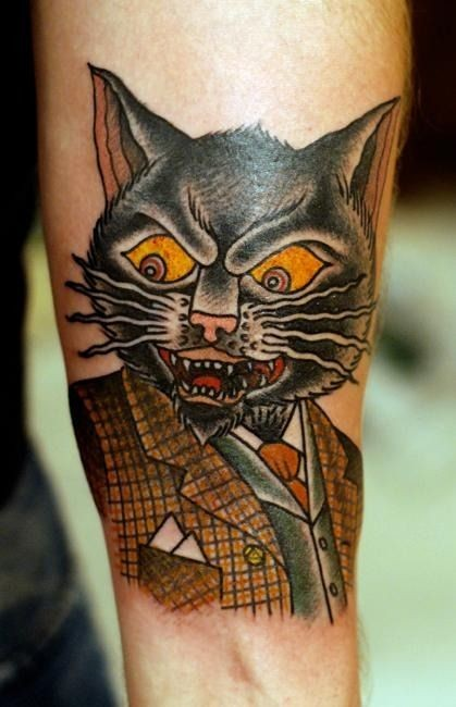 beautiful cat portrait with frame tattoo on shoulder photo - 2