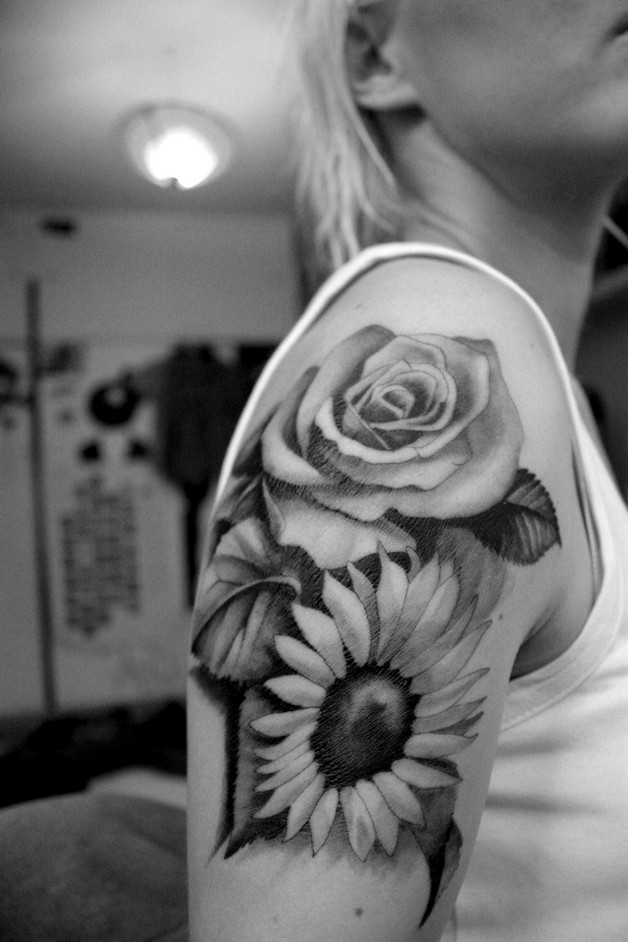beautiful sunflower tattoos on upper back photo - 1