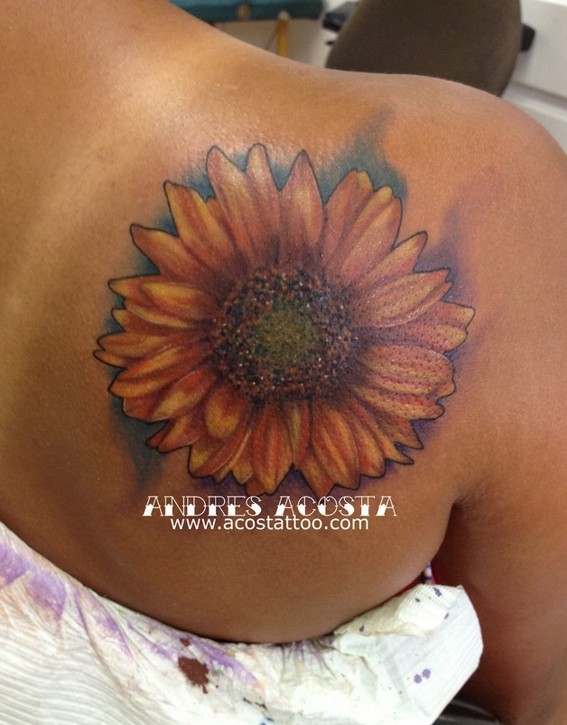 big unique sunflower tattoo on back photo - 1