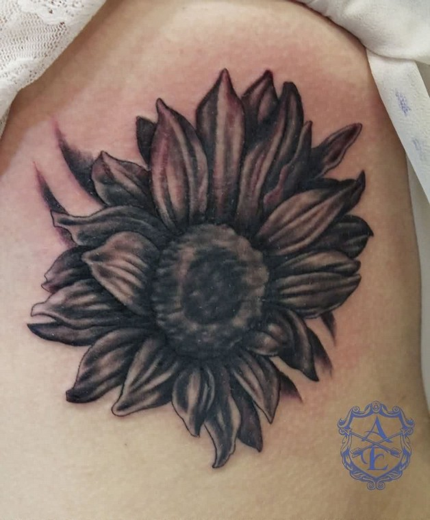 birds flying from sunflower tattoo on back shoulder photo - 1