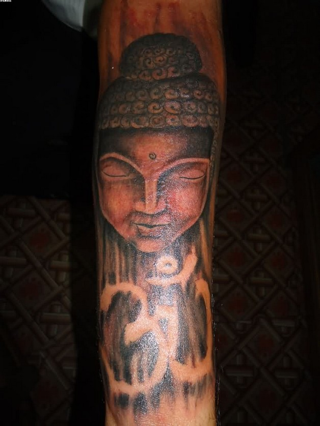 buddhist om religious tattoo on arm photo - 1