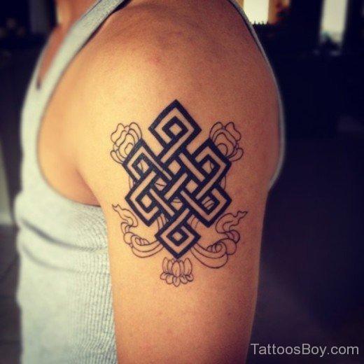 buddhist om religious tattoo on arm photo - 2