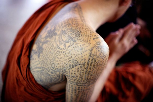 buddhist tattoo on shoulder back photo - 2