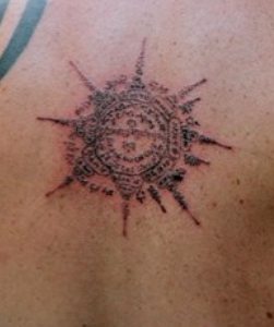 buddhist wheel tattoo design photo - 1