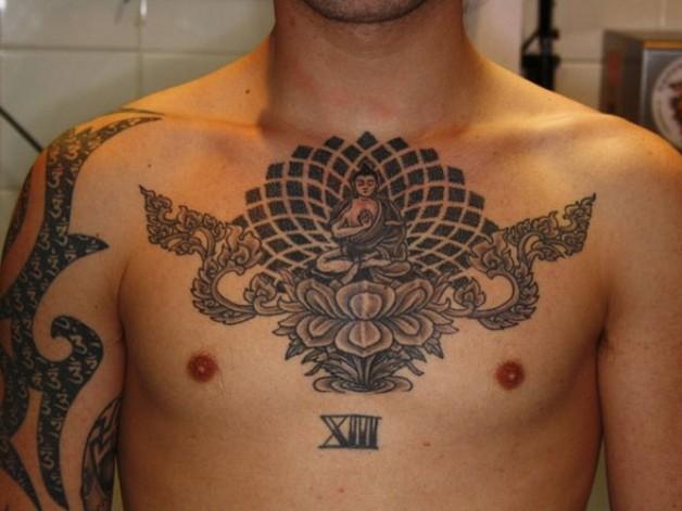 buddhist wheel tattoo on chest photo - 2