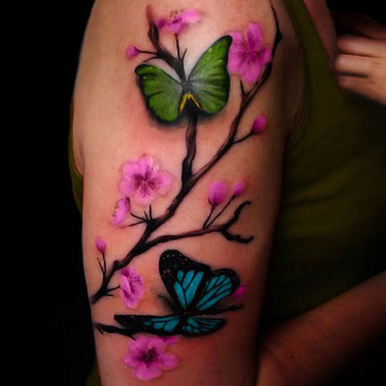 Butterfly With Cherry Blossom Flowers Tattoo