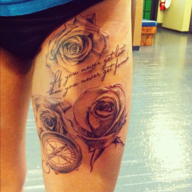 camera flowers tattoo on thigh photo - 1