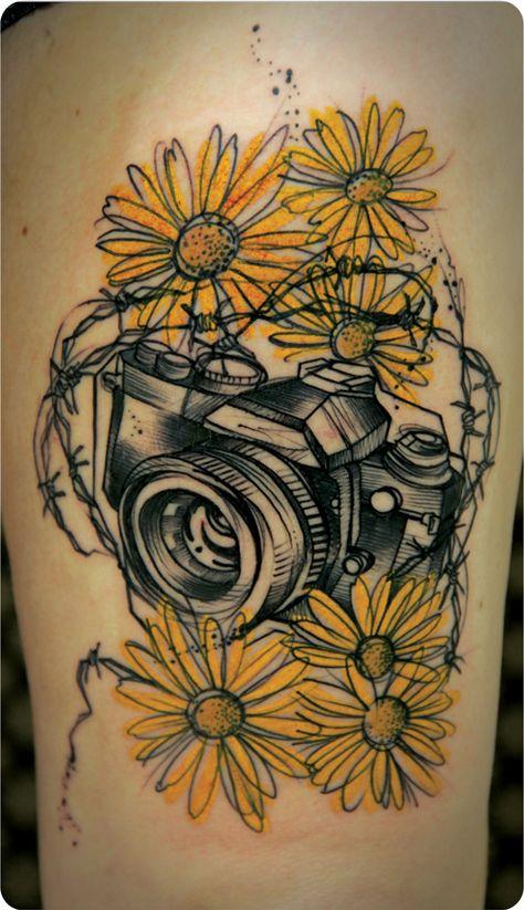 camera flowers tattoo on thigh photo - 2