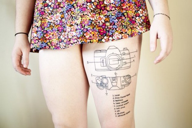 camera with flowers tattoo on thigh photo - 1