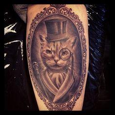 cat portrait in blue frame tattoo photo - 1