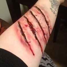 cat scratching tattoo design photo - 2