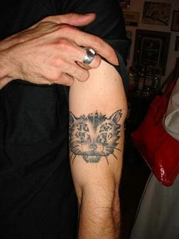 cat tattoo on muscle for men photo - 1