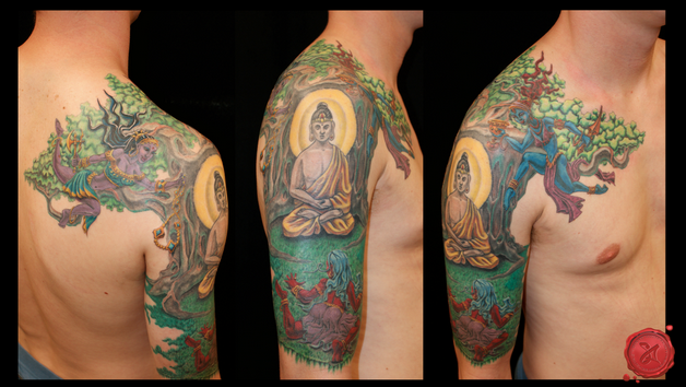 colorful buddhist tattoo on shoulder photo - 1