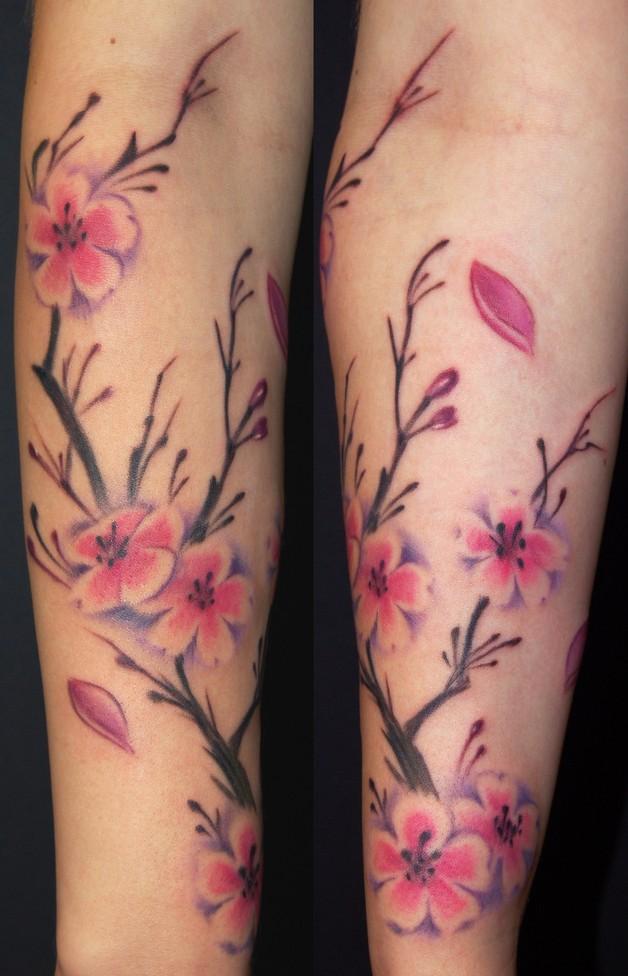 colorful feminine flowers tattoo on sleeve photo - 1