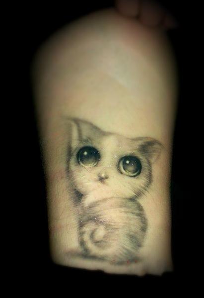 cute cat tattoo on finger photo - 2