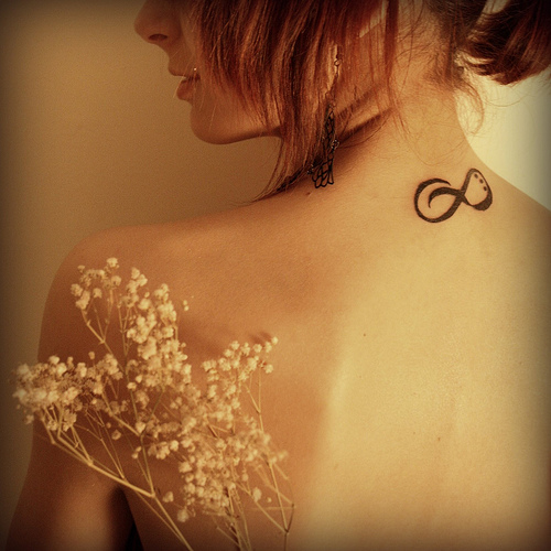 cute cat tattoo on neck back photo - 1