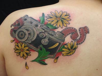 daisy flowers camera film tattoo on shoulder back photo - 1