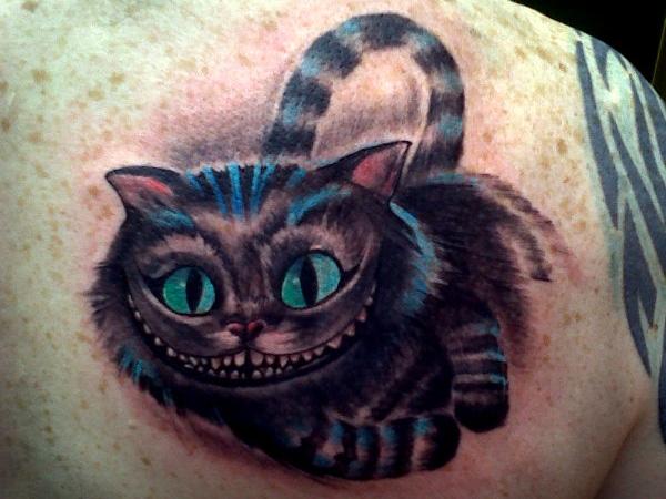 demonic cheshire cat tattoo photo - 2