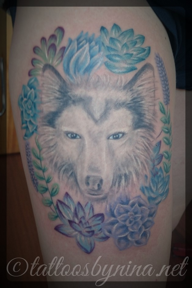 dog portrait frame tattoo on thigh photo