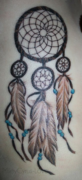 dream catcher tattoo on shoulders with tiny stars photo - 1