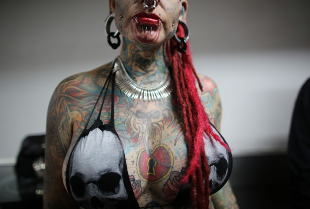 extreme piercing n body modifications tattoo for girls photo - 1