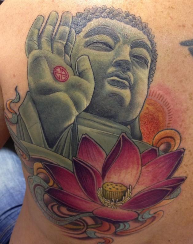 eye catching lotus flower tattoo on chest photo - 1