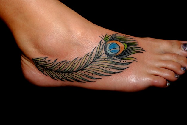 feminine birds tattoo on toe photo - 1