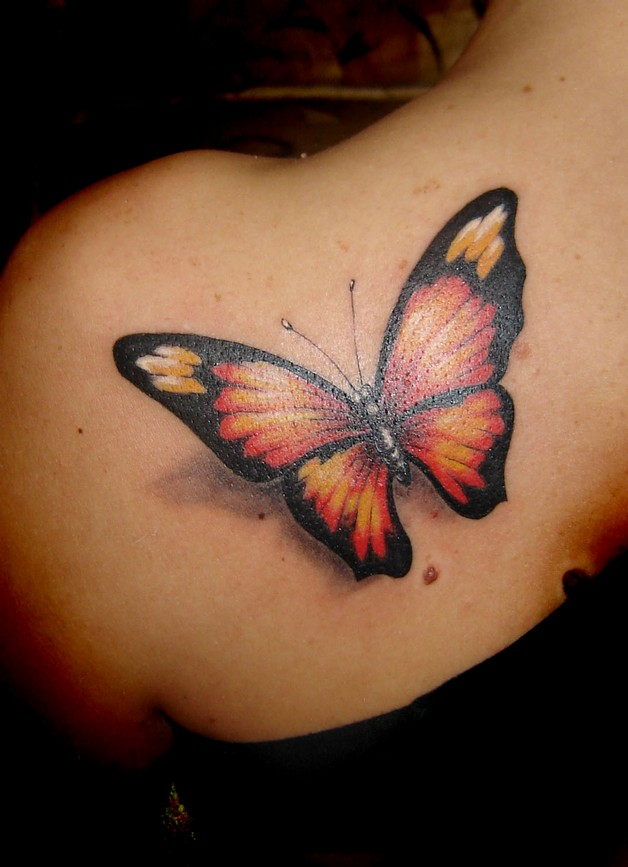 feminine black 3d bow tattoo on the back photo - 1
