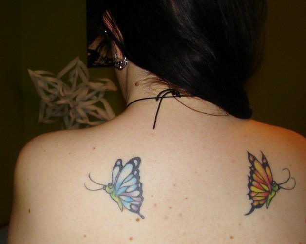 feminine tattoo for upper back photo - 1