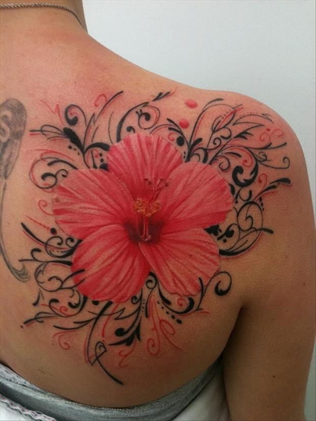 flowers and grey 3d tattoos on back photo - 2