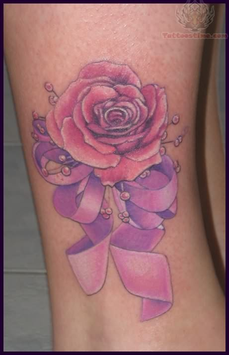 flowers breast cancer ribbon tattoo on foot photo - 2