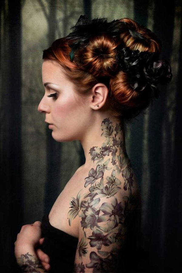 grey 3d flowers skull and woman skull tattoos on side photo - 2