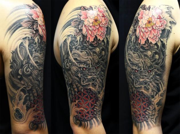 grey ink asian foo dog half sleeve tattoo photo - 1