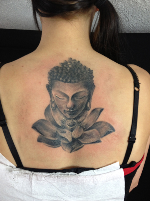 grey ink buddhist lotus tattoo on upper back photo - 1