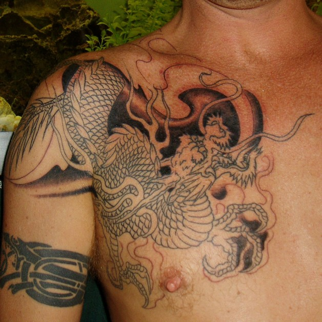 grey ink dog portrait tattoos on upperback photo - 1