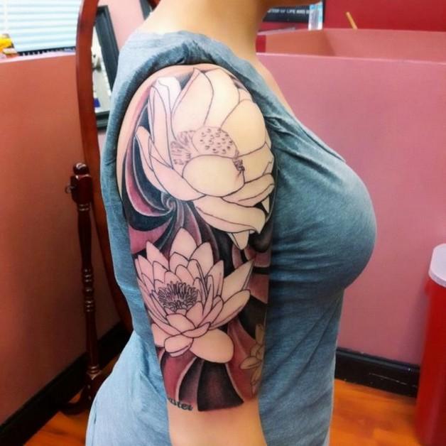 Japanese flowers and pheonix tattoos on half sleeve