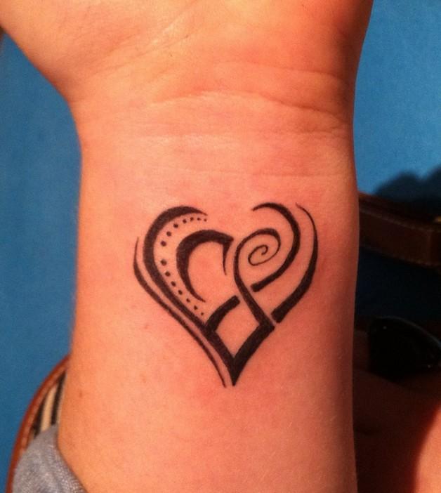 music cat tattoo on wrist photo - 1
