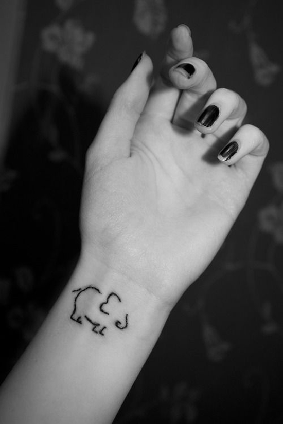 music cat tattoo on wrist photo - 2