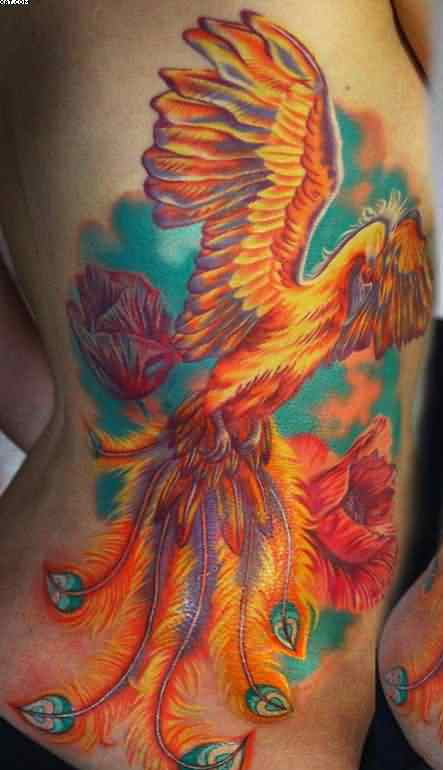 phoenix with flowers tattoos on side photo - 1