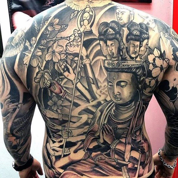 religious buddhist tattoo on back for men photo - 2